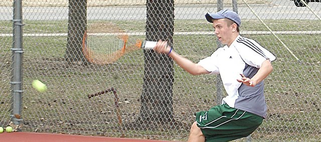 Sophomore Andrew Konetzni volleys a ball in the regular season. Konetzni won the De Soto Invitational tournament, and looks to be a top-three seed in regionals.