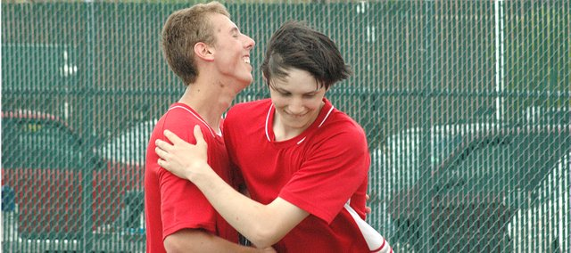 Lansing High seniors Eric Hansen, left, and Daniel Miskowic celebrate after qualifying for state in doubles at the Class 5A regional tennis tournament.