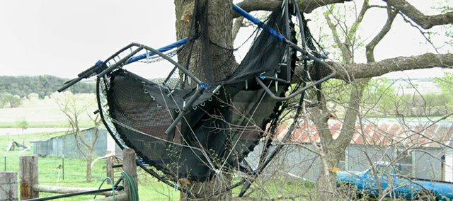 Winds early Friday morning threw a trampoline near Andy and Stephanie Maurer's rural Tonganoxie home into a tree. A nearby barn also was destroyed because of the severe storm.