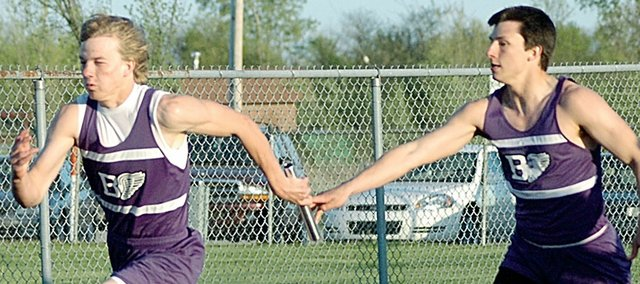 Baldwin High School senior Dustin Schiller, left, grabs the baton from BHS junior Sam Beecher during the 400-meter relay Friday night at the Redbud Classic. Schiller anchored the relay the a second-place, before turning around and winning the next event, the 400-meter dash.