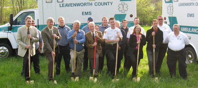 Breaking ground at the new Leavenworth County EMS station, south of the intersection of 16th Street and Metropolitan Avenue, Monday morning were: (back row from left) Dennis Ryan, Chris Maleta, Steve Getter, Tony Shankle, Jennifer Routt, Dave Mellen, Michelle Westfall, Gary Snow, Brian Bailey, Pat Morey and John Gilmore; (front row from left) Don Pruitt, J.C. Tellefson, Dean Oroke, Clyde Graeber, Jamie Miller, Heather Morgan and Gordon Kimble.