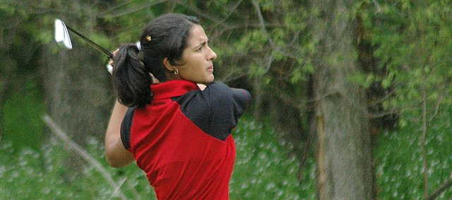 Lansing High senior Maria Jackson watches her tee shot soar toward the green on No. 17 on Monday at the Kaw Valley League championships at Eagle Bend Golf Course in Lawrence. Jackson was the league champ with a 75.