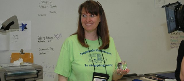 Tonganoxie Elementary School teacher Karen Stockman was awarded the crystal apple award by Fox 4 on Friday. Stockman is the first Tonganoxie schools teacher to receive the television station's award.
