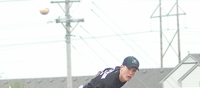 Daniel Peterson delivers a pitch Tuesday night against Eudora. De Soto swept the Cardinals, 11-1 in the first game and 8-4 in the second. The Wildcats have won eight of their last 10 games heading into the sub-state tournament.