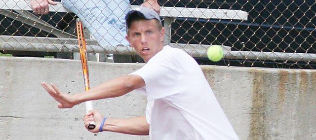 Andrew Konetzni returns a serve Friday at the sub-state tournament. Konetzni and Matt Edwards, both singles players for De Soto, advanced into the state tournament.