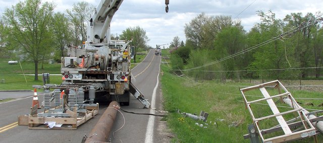 Eleven power line poles along 158th Street from Metro Avenue to Kansas Highway 32 were blown down by storms Thursday night and early Friday. Westar Energy workers spent several hours repairing the poles and restoring electricity to a number of Basehor residents.