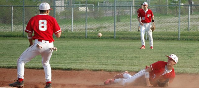 Shortstop Ethan Lorrance tosses the ball to second baseman Kieth Wentz-Hall after making a diving grab for Tonganoxie High during the team's 8-5 Senior Night win against Mill Valley.