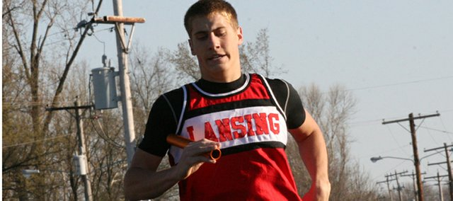 Bobby Hauver, seen here competing at the Tonganoxie Invitational, helped the Lansing High 3,200-meter relay team win the Kaw Valley League championship.