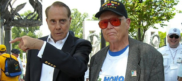 Former U.S. Senator Bob Dole chats with World War II and Korean War veteran Robert McCullough of Tonganoxie on May 3 during McCullough's visit to the National World War II Memorial.