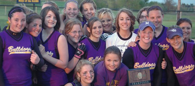 The McLouth High softball team poses with its regional championship plaque after defeating Wellsville, 7-1, on Wednesday to earn a trip to the state tournament.