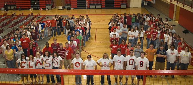 The Tonganoxie High School Class of 2008 form a giant 08 in the gymnasium for a group photo after graduation rehearsal Thursday.  THS graduation will begin at 7 p.m. Saturday at Beatty Field.