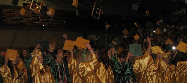 Members of the Class of 2008 from Basehor-Linwood High School and Basehor-Linwood Virtual School celebrate their graduation by throwing their mortarboards into the air at the conclusion of the commencement ceremony