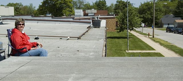 Tonganoxie Elementary School principal Tammie George spent the school day Tuesday, May 20, 2008, on top of the TES roof to recognize third- and fourth-grade students for meeting the building goals for state assessment scores in math and reading.