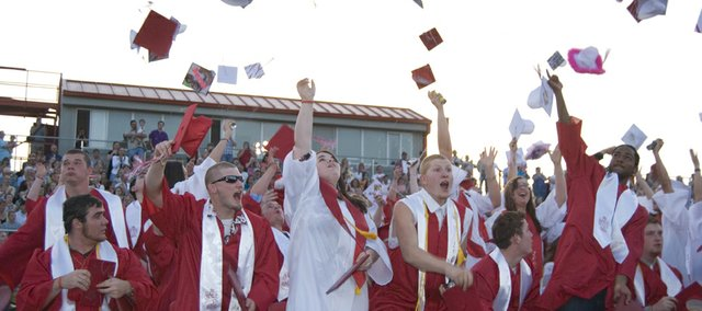 Members of the Tonganoxie High School class of 2008 toss their mortarboards into the air at Saturday's graduation.