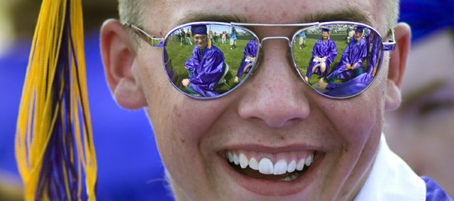 Members of the MHS class of 2008 are seen reflected off Jake McCormick's glasses.f