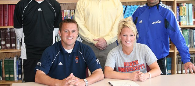 Alyssa Kelly, the leading scorer on the Bonner Springs girls soccer team, will play soccer in college next year at Baker University. Pictured at the signing ceremony are, from left, seated: BU assistant coach Blake Reynolds and Alyssa Kelly; and, standing: BSHS coach Mike Mullin, Tim Kelly and BSHS assistant coach Shannon Frank.
