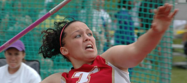 Roxi Grizzle unleashes a state-record throw of 165 feet, 5 inches in the girls javelin to win a state title Saturday in Wichita.