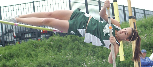 Pole vaulter Cheyenne Williams attempts to get over the bar Saturday at the state track meet at Wichita State's Cessna Stadium. Williams placed 12th, but set a new De Soto High record with a vault of 10 feet.
