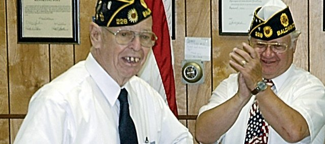 Archer Carlson, left, longtime Baldwin City resident and member oft he Lloyd Beaton American Legion Post, was honored for his decades of service to the post during Monday's Memorial Day services in the Legion Hall. Standing next to him is Larry Francq, local commander.
