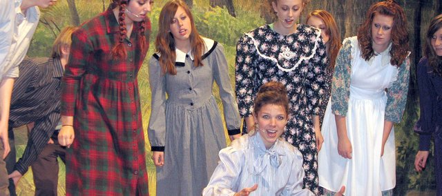 "Anne Shirley (left), played by Nicole Theno, and classmates gather around their teacher Muriel Stacy, played by Andrea Adcox, during dress rehearsals for the Basehor-Linwood High School Musical production of ""Anne of Green Gables"" in November 2007. Adcox recently was nominated for a Blue Star Award for Best Featured Performer for her role as Miss Stacy."