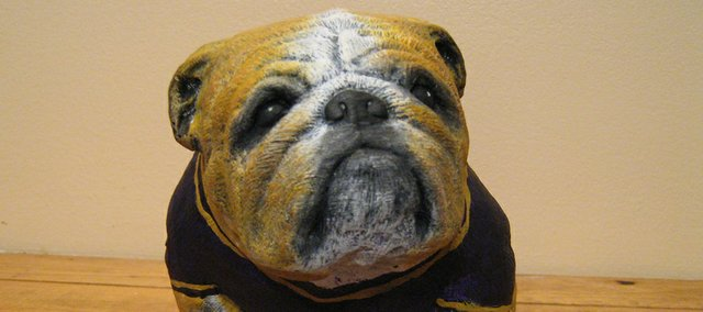 This bulldog is one of 30 miniature concrete bulldog that McLouth High School art students, McLouth Elementary students and other community members painted for a fundraising auction Saturday.