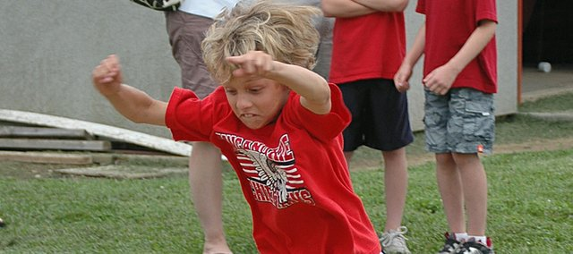Wyatt Zarda, 9, of Tonganoxie takes off in the standing long jump. He finished first in his age group with a jump of 5 feet, 8 inches at the local qualifying meet for the Hershey's Track and Field Games.
