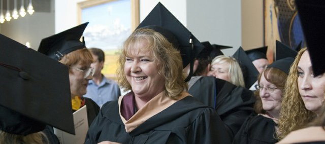 Kathy Bard, assistant city administrator and city clerk, graduated Saturday with a master's degree in business administration from the University of Phoenix. The school's commencement ceremony was held at the Overland Park Convention Center.
