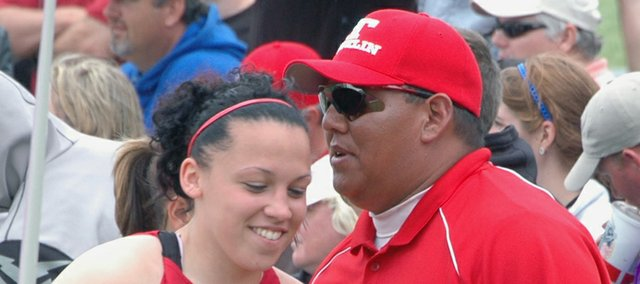 Tonganoxie High javelin coach Dave St. Cyr shares some knowledge with one of his star pupils, two-time Class 4A state javelin champ Roxi Grizzle. St. Cyr talks with his athletes between throws at meets to help ease the pressure.