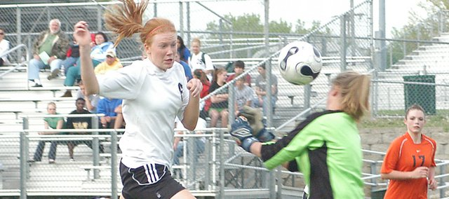 De Soto senior Nicole Radcliffe hits a header past a Bonner Spring opponent in her last home game of her career. Radcliffe finished the year with 57 career goals, most in the four-year history of the program.