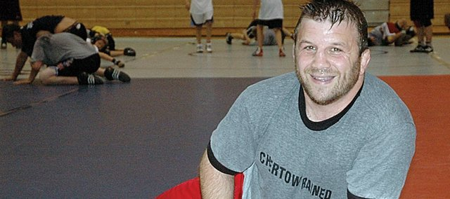 Ken Chertow, a 1988 Olympic wrestler, laughs while wrestling clinician and former Kansas state champion Aaron Ely Sunday afternoon. Chertow held one of his summer camps at Baker University this weekend.