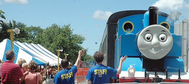 Visitors and workers wave goodbye to Thomas the Tank Engine as the train leaves the Midland Railway Depot to make one of his runs Friday at the annual A Day Out with Thomas. The event will run Saturday, Sunday and next weekend.