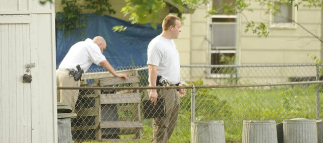Lawrence Police work the scene on Saturday June 7th, 2008 of a early morning shooting around 2:45 at 1311 Delaware. Two people were reported shot and dead at the scene.