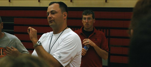 Tonganoxie High boys basketball coach Shawn Phillips addresses high school campers last week at THS basketball camp. Phillips, entering his first year as coach of the Chieftains, and returning varsity players used the camp as a chance to get a better feel for one another.
