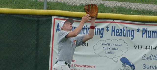 Tonganoxie center fielder Brandon Yoder tracks a fly ball for Tonganoxie in the second inning of the Chieftains' 8-0 loss to Piper on Thursday.