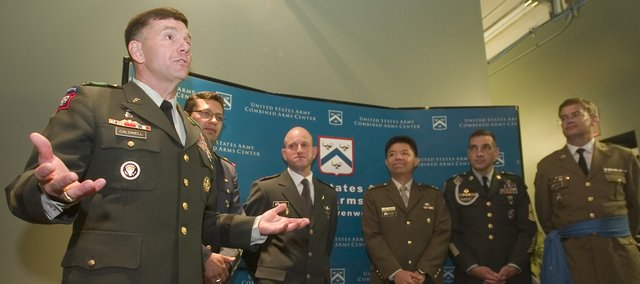 Lieutenant General William B. Caldwell, IV (left) leads a press conference Thursday with some of the CGSG graduates following the badge ceremony at Fort Leavenworth.