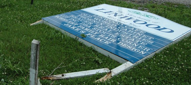 Thursday's storms left a sign welcoming visitors to Linwood on the ground. Residents were cleaning up damage to the southern Leavenworth County community, primarily fallen tree limbs. Roof damage also was reported in the city. And, a tornado was reported in the area during Thursday's storms.