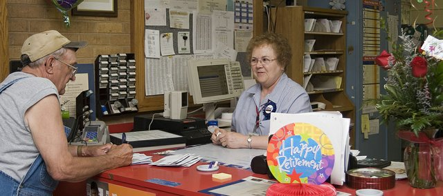Shirley Martin helps a customer during her last working day on May 30.
