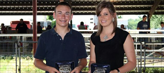 Blaine McDougal, left, was the Champion Senior Showman and Kylie Stinson was the Reserve Senior Showman at the Leavenworth County Spring Swine Show.