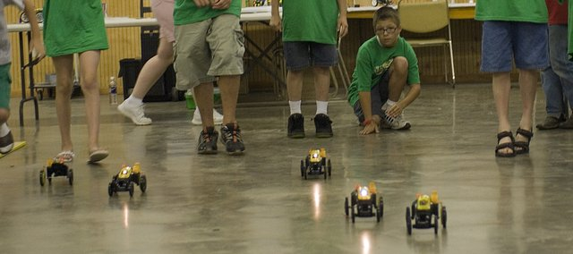 Leavenworth County 4-H'ers learned about robotics by using programmable toys to build a race car.