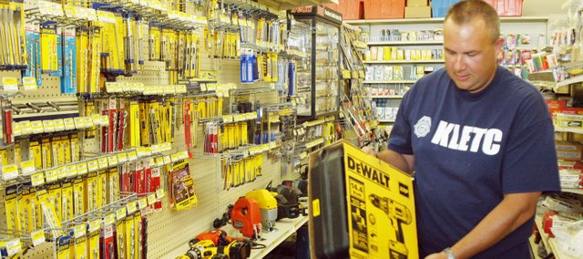 Mike Underwood looks for potential purchases Thursday at Durkin's hardware after winning a $1,000 shopping spree.