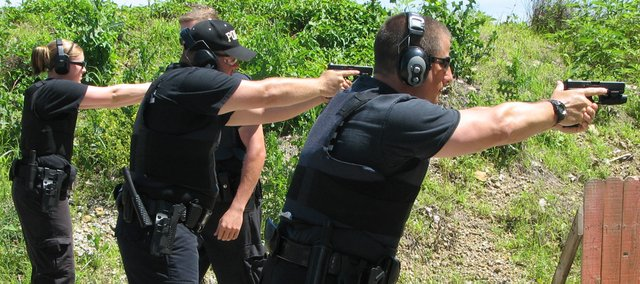 Basehor Police Officers (from left) Jennifer Bridgman, Erik Lynnes and Sgt. Greg Hallgrimson go through a series of combat drills before qualifying with new department issued Glock 22 and 23 handguns June 18 in Tonganoxie.