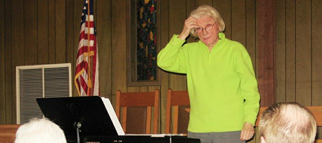 Conductor Elvera Voth contemplates a question during the East Hill Singers' rehearsal.