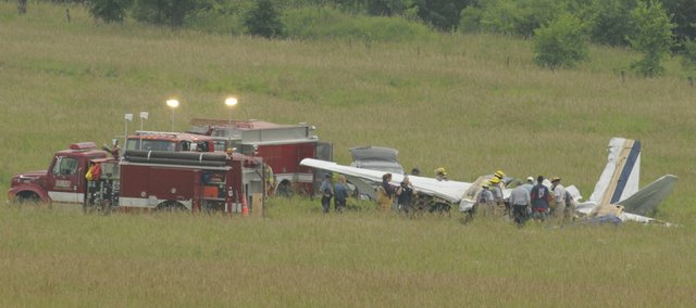 Federal Aviation Administration personal and Kansas Highway Patrol Troopers work the scene of a plane crash about 6 p.m. Tuesday, June 24 near the intersection of Leavenworth County Road 1 and Cantrell Road south of Tonganoxie. Two people were killed in the crash, which occurred about 10:30 a.m. Tuesday.