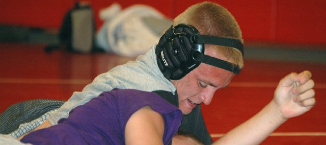 Jeff Ross keeps his opponent on the mat during an Unlimited Fitness Wrestling League match on Thursday at Tonganoxie High. Ross, a rising junior at THS, was one of more than 50 grapplers to participate in the UFWL, held every Thursday evening in June at THS.