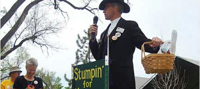 Bob Topping, host of the Prairie Queen Bed and Breakfast in Leavenworth and a board member of the city's Convention and Visitors Bureau, gives a stump speech promoting Leavenworth culture at the 2007 Kansas Sampler Festival in Garden City. County commissioners, on Monday, approved a funding agreement for the festival should it be brought to Leavenworth in 2010 and 2011 and will pass that agreement on to the four major cities in the county for approval.