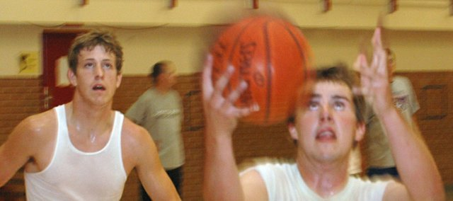 Jamie Everett, right, goes in for a layup as Austin Smith follows during Tonganoxie High basketball camp in June. The Chieftains spent their Monday evenings that month competing against other prep teams from Kansas and Missouri at Rockhurst University in Kansas City, Mo. Tonganoxie won three of their last four games in the summer league and went 4-6, overall.