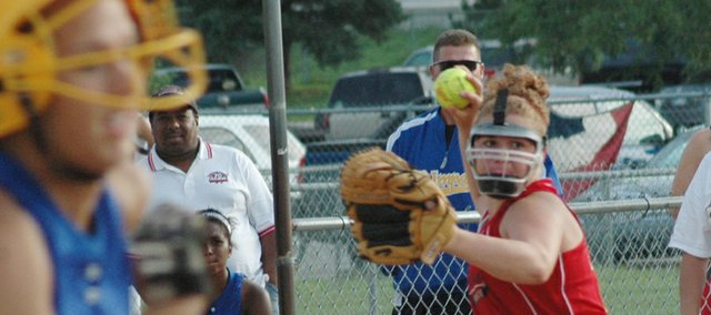 Lindsey Fatherley, third baseman for the Tonganoxie Braves (18-and-under), looks to throw out a KC Impact runner on Saturday at the USSSA Softball State Tournament at Mid-America West Sports Complex in Shawnee. The Braves defeated the Impact, 2-0, in the consolation bracket.