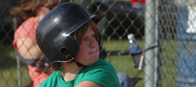 Sonny Mangelsdorf of the Gators, a 10-and-under baseball team in the Tonganoxie Recreation Commission league, watches a pitch come toward home plate on Friday evening at Leavenworth County Fairgrounds.