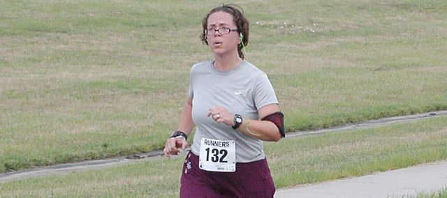Julie Tollefson makes her way to the finish line Saturday during the Eudora Horsethief 5K Race. Tollefson ran in the race along with her husband, John, and son, Jacob.