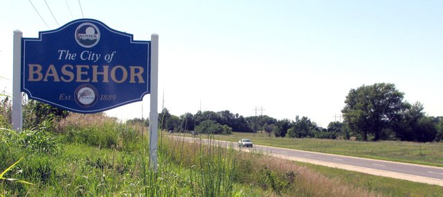 A city of Basehor sign sits just west of 166th Street on U.S. Highway 24-40 to mark the nearby Honey 